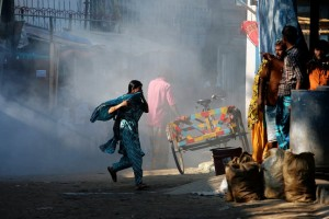 Tear Gas fired at demonstrators protesting the death of two Bangladesh garment workers