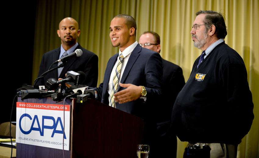 Left to right: CAPA president Ramogi Huma, Northwestern University quarterback Kain Colter, United Steelworkers (USW) national political director Tim Waters, and United Steelworkers (USW) president Leo W. Gerard during a press conference for CAPA College Athletes Players Association.